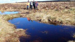 Staff from RSPB, Scottish Water and the contractor, McGowan Ltd, discuss the successful works at Moss of Kinmundy