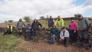 Volunteer group with newly built dry stone wall