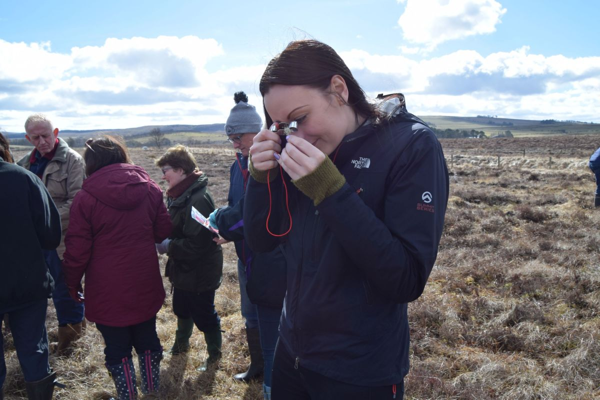Depute Provost Claire Leitch examines a lichen (c) East Ayrshire Council