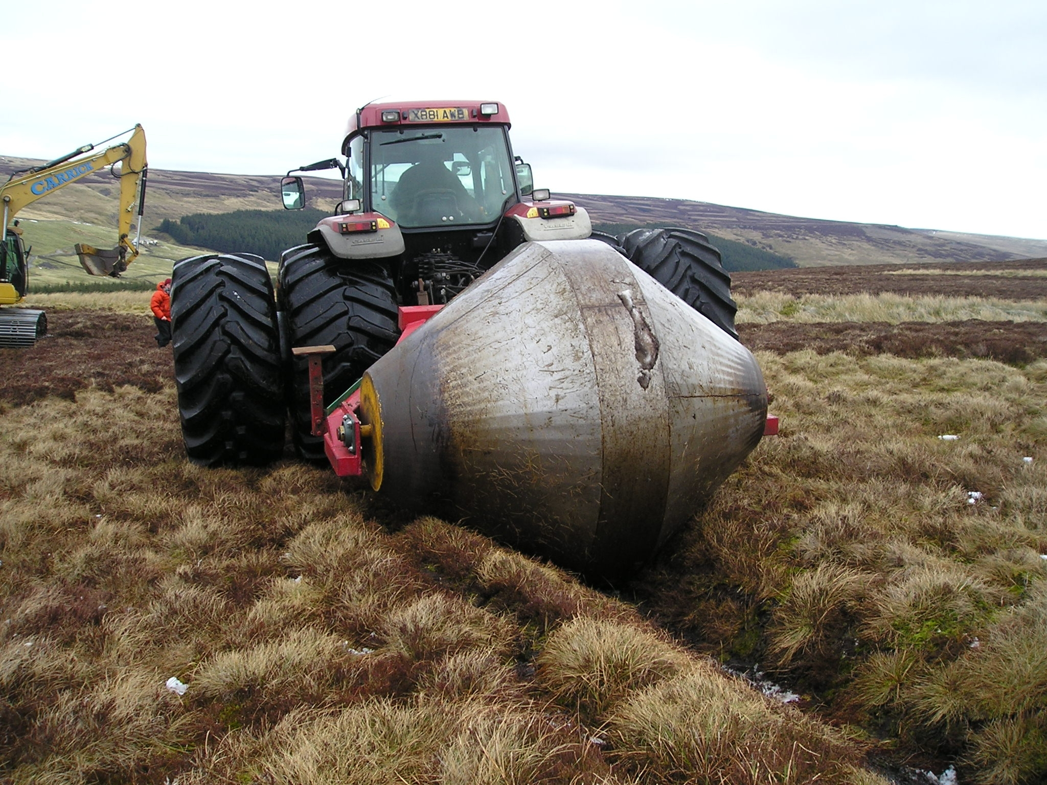 Restoration work using a grip reprofilier - Credit North Pennines AONB